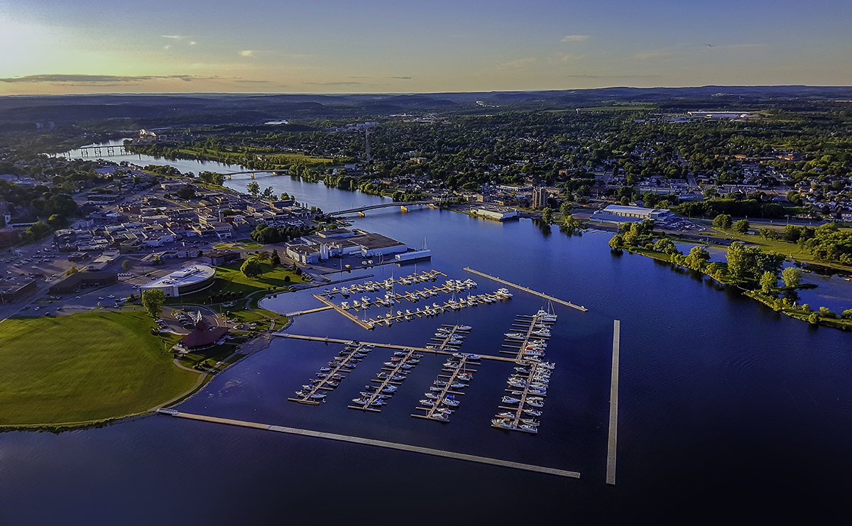 An aerial photo of the City of Quinte West with lots of water and trees.